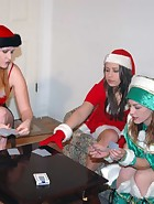 At their Christmas party, Clare and Virginia (played by Julie Simone) are playing games with Kay and Sierra. Spanking games of course. Cards lead to plenty of spankings in different positions and with hands and implements. This is the last ever new spanki, pic #1