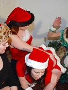 At their Christmas party, Clare and Virginia (played by Julie Simone) are playing games with Kay and Sierra. Spanking games of course. Cards lead to plenty of spankings in different positions and with hands and implements. This is the last ever new spanki, pic #14