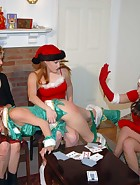 At their Christmas party, Clare and Virginia (played by Julie Simone) are playing games with Kay and Sierra. Spanking games of course. Cards lead to plenty of spankings in different positions and with hands and implements. This is the last ever new spanki, pic #3