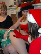 At their Christmas party, Clare and Virginia (played by Julie Simone) are playing games with Kay and Sierra. Spanking games of course. Cards lead to plenty of spankings in different positions and with hands and implements. This is the last ever new spanki, pic #4