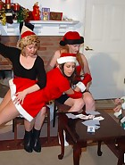 At their Christmas party, Clare and Virginia (played by Julie Simone) are playing games with Kay and Sierra. Spanking games of course. Cards lead to plenty of spankings in different positions and with hands and implements. This is the last ever new spanki, pic #6